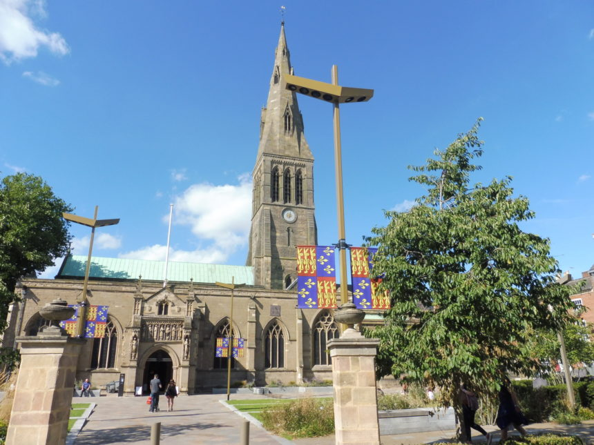England Richard III Leicester Cathedral outside with flags